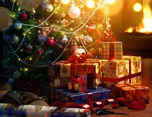 Christmas tree and holidays present on fireplace background